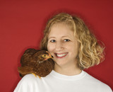 Caucasian woman with chicken on shoulder. poster