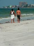 lovers walking the beach poster