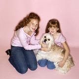 Girls holding Cocker Spaniel dog. poster