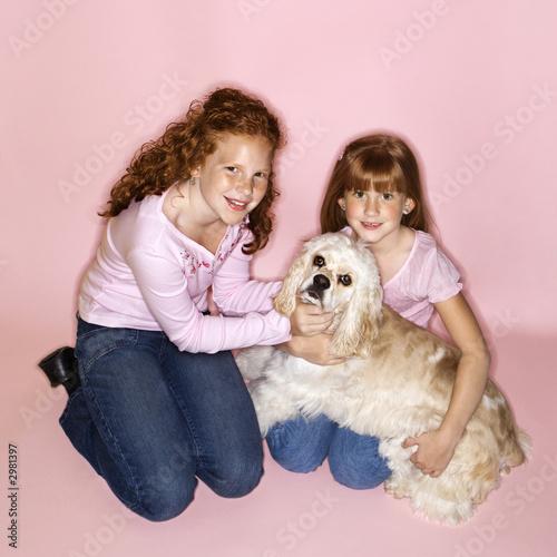 poster of Girls holding Cocker Spaniel dog.