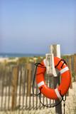 Life preserver on beach on Bald Head Island, North Carolina. poster