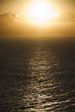 Sun reflected on ocean. poster