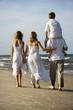 Family walking down beach.