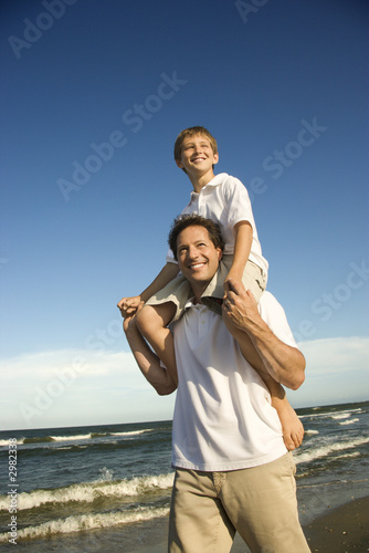 poster of Dad carrying son on his shoulders.