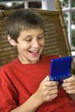 Boy playing video game. poster