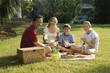 Family having picnic in park.