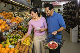 Couple grocery shopping. poster