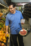 Man grocery shopping. poster