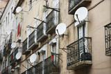 Apartment building with satellite dishes in Lisbon, Portugal. poster