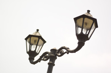 two lampposts in the sky