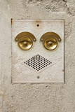 Ringer and speaker that look like a face in Venice, Italy. poster