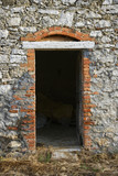 Doorway into old stone building in Tuscany, Italy. poster