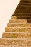 a sand stone staircase in shadow poster