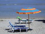 beach chairs & parasol poster