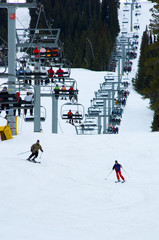 busy snow ski resort with chairlift
