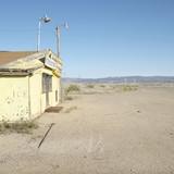 old trading post in desert landscape of utah. poster