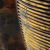 rusty old radiator grill. poster