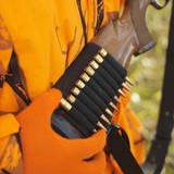 hunter removing bullet from ammo holder. poster