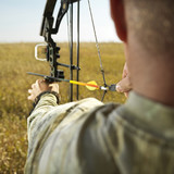 bow hunter with compund bow. poster