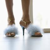 Feet in furry heels. poster