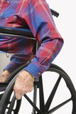 hands gripping wheels of wheelchair. poster