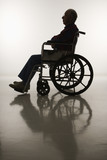 silhouette of elderly man in wheelchair. poster