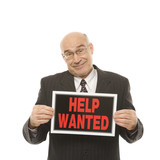 businessman holding help wanted sign. poster