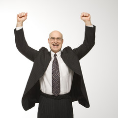 businessman jumping with arms raised.