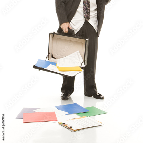 poster of businessman losing papers from briefcase.