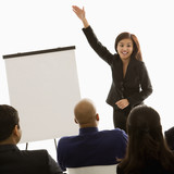businesswoman giving presentation in front of others. poster