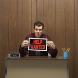 retro businessman holding help wanted sign. poster
