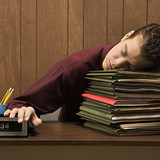 overworked retro businessman sleeping at desk. poster
