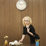 woman wearing vintage outfit in office touching calculator. poster