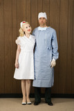 female nurse and male surgeon standing together. poster
