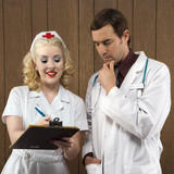 nurse and doctor looking at clipboard. poster