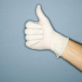 hand wearing rubber glove giving the thumbs up signal. poster