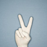 hand wearing rubber glove making peace gesture. poster