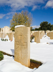 military cemetery covered with snow on a clear day