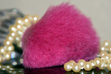 pink makeup brush with pearls