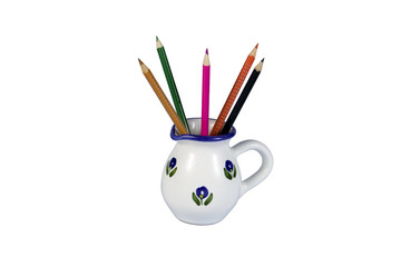 white pitcher with pencils