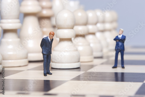 business figurine and chess - 3016318
