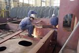 A worker is welding steel poster