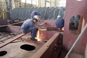 A worker is welding steel