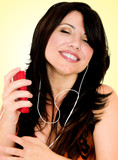 brunette with electronic mp3 player poster