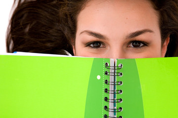 beautiful female student peeping over a green note
