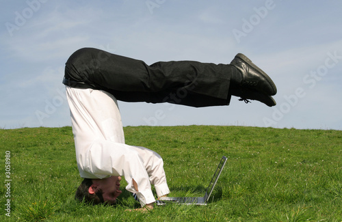 businessman upside down using laptop
