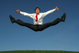 businessman doing splits in mid-air poster