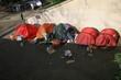 Leinwanddruck Bild - homeless in row