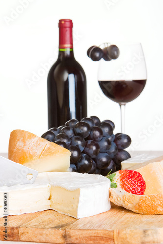 a cheese selection with a bottle of wine