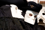 two venetians in black costumes and white masks poster